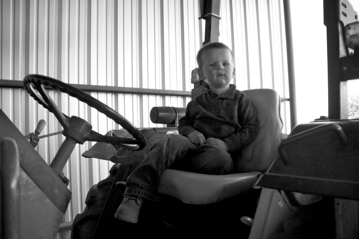 little boy and the tractor